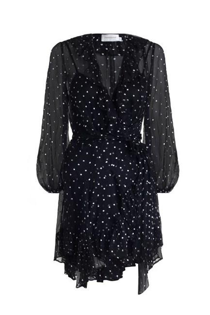 "Adorn Ruffle Wrap Dress, $795, <a href=""https://www.zimmermannwear.com/readytowear/clothing/dresses/adorn-ruffle-wrap-navy-pearl-dot.html"" target=""_blank"">Zimmermann</a>."