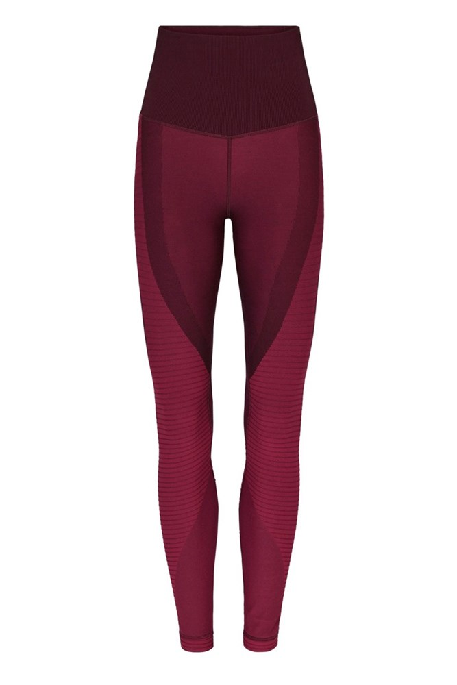 """<a href=""""https://www.modesportif.com/shop/product/nike-zoned-sculpt-training-tight-in-night-maroonnoble-redblack/"""">Tights, $150, Nike at modesportif.com</a>"""