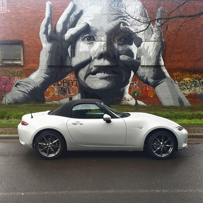 Mazda's MX5 convertible taking in some street art at Castlemaine's The Mill
