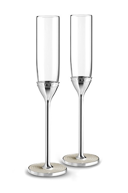 "<strong>Champagne flutes.</strong> <br><br>Because toasting feels much more elegant when it's done properly. <br><br>With Love Nouveau Pearl Toasting Flutes, $119, <a href=""https://www.wedgwood.com.au/vera-wang-wedgwood-with-love-nouveau-pearl-toasting-flutes.html"">Vera Wang Wedgwood</a>"