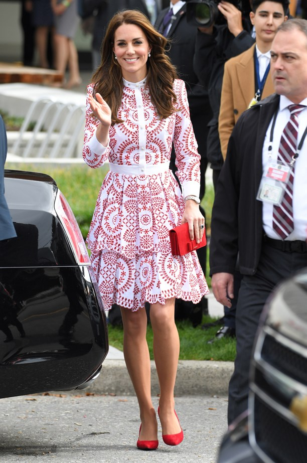 For their second event, Kate wore this red and white Alexander McQueen tiered dress, which she paired with red shoes and a red clutch.