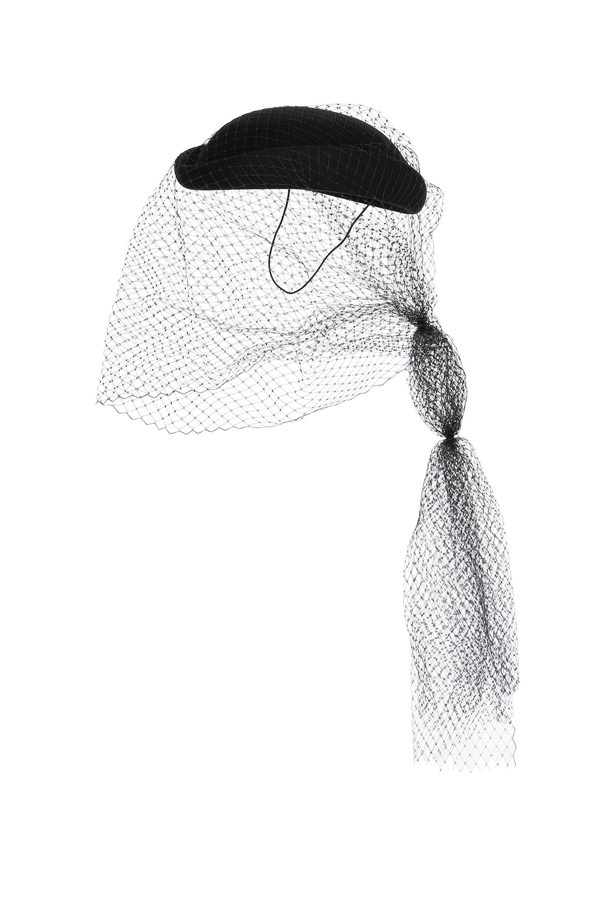 """<a href=""""http://www.luisaviaroma.com/gucci/women/hats/64I-H0I009/lang_EN/colorid_MTAwMA2?SubLine=accessories&CategoryId=53"""">Hat with veil, $560, Gucci at luisaviaroma.com.</a>"""