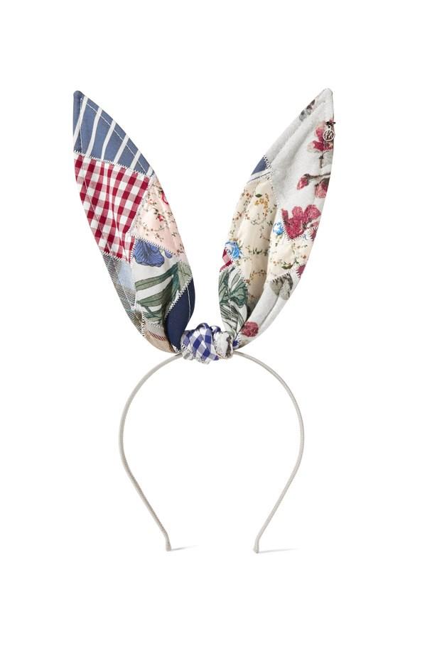 """<a href=""""https://www.net-a-porter.com/au/en/product/650646/maison_michel/heidi-patchwork-cotton-bunny-ears-headband"""">Headband, $711, Maison Michel at net-a-porter.com.</a>"""