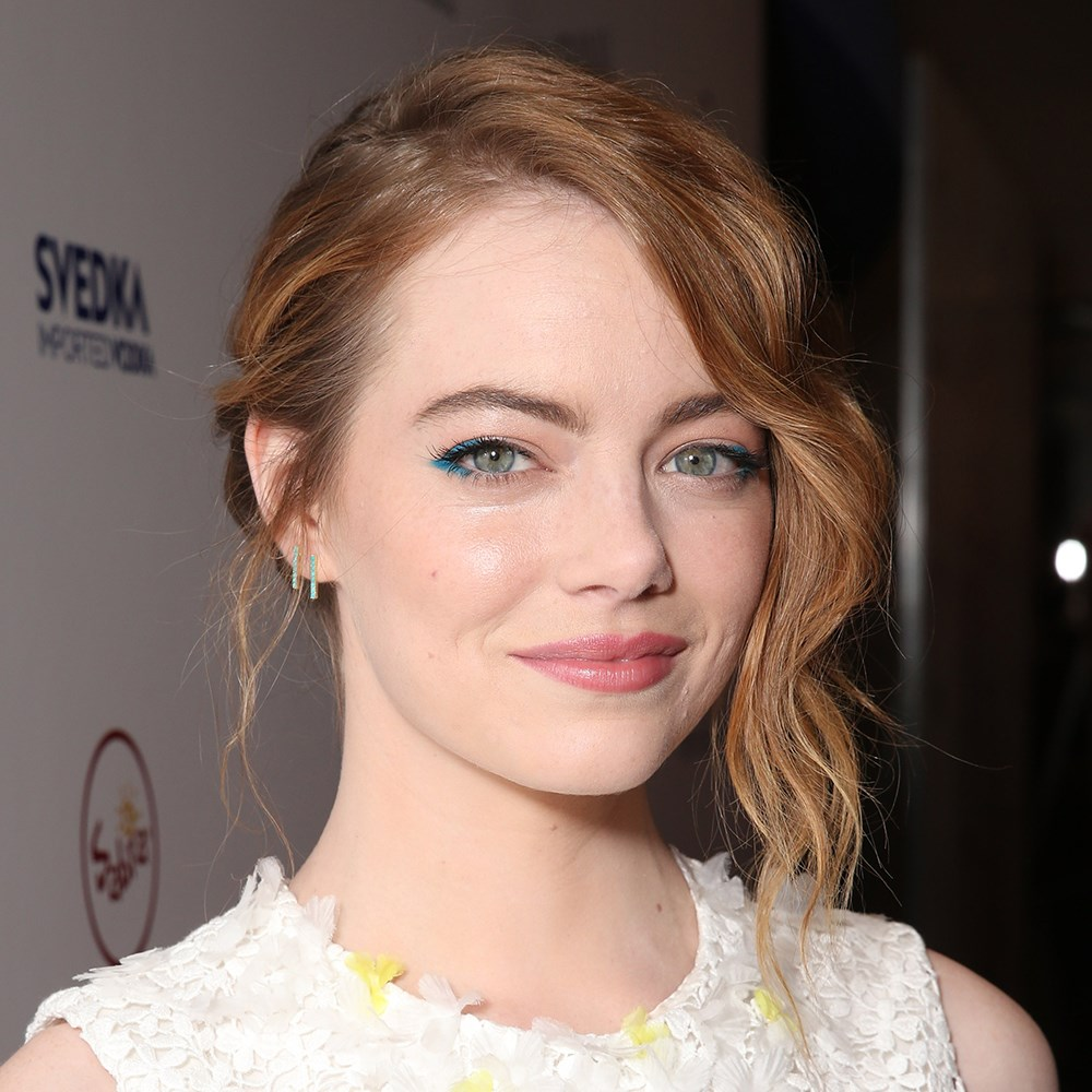 <p>Emma Stone's style featured different-sized fishtail braids. The loose waves at the front add softness.