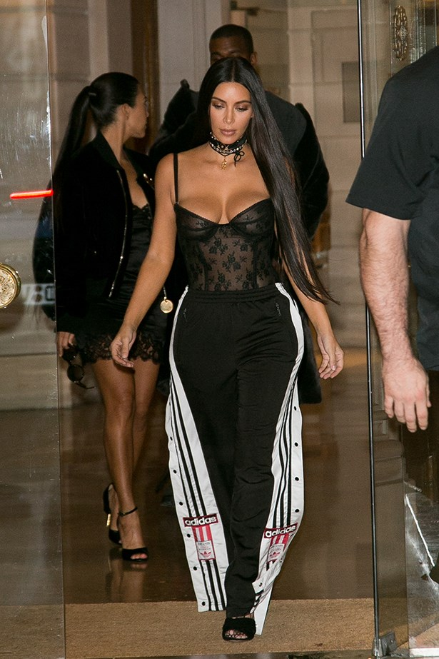 Stepping out in Paris, Kim paired her black corset top with those snap-detail trackpants everyone used to wear in high school. Chic.