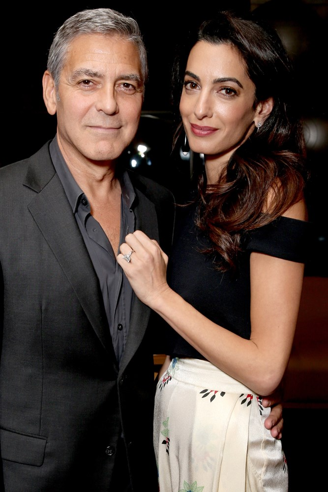 <strong>George Clooney and Amal Alamuddin Clooney</strong><br> The couple met at a charity function in 2013, with Clooney believed to have worked to woo the human rights lawyer. They married the next year.