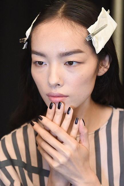 Think you can't wear dark polish in spring? Think again. <strong>Vera Wang</strong> debuted a mega-chic negative space manicure featuring a vertical ebony stripe. The ultimate black tie wedding manicure. Matte top coat optional.