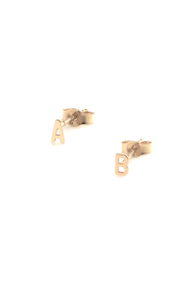 """<strong>Monogram earrings</strong><br> Gift her with her initial(s).<br><br> <a href=""""https://www.sarahandsebastian.com/collections/earrings/products/petite-letter-earring?variant=1189388087"""">Earrings, $90 each, Sarah & Sebastian</a>"""