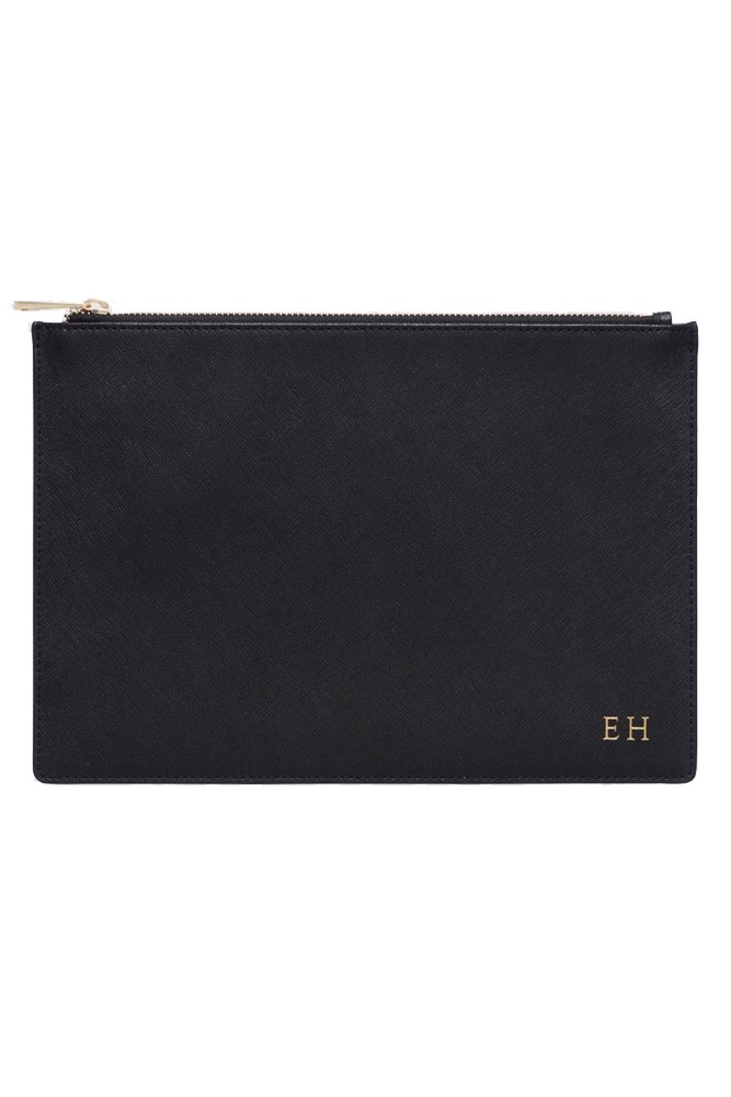 """<strong>A personalised clutch</strong><br> Whether it's in versatile black, or a hue that matches your wedding aesthetic, so that your bridesmaids can carry them on the day. <br><br> <a href=""""https://www.thedailyedited.com/black-large-pouch"""">Pouch, $119.95, The Daily Edited</a>"""