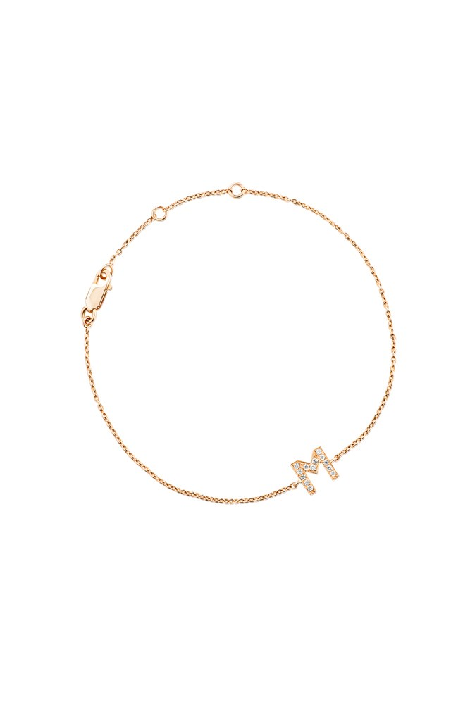"""<strong>A personalised bracelet</strong><br> That she can wear on the day, and long after. <br><br> <a href=""""http://www.aristidesfinejewels.com/diamond-letter-monogram-bracelet-yellow-gold/"""">Yellow Gold Bracelet, $445, Claire Aristides</a>"""