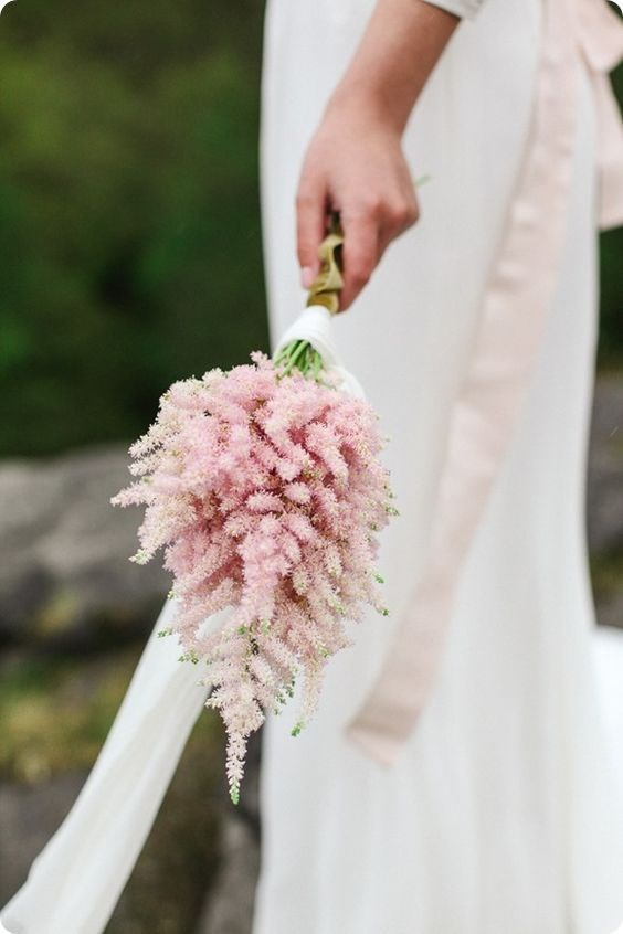 "<p> <em>Astilbe</em><p> <p> Like baby's breath, astilbe has taken a supporting role in bouquets of late, but it's slowly coming into its own. Perfect for a simple posey, as opposed to a large bunch, astilbe (which is its prettier name, in contrast to 'false goat's beard') is delicate and dense.<p> <p> Image via <a href=""https://au.pinterest.com/pin/409686897337297516/"">Pinterest</a>."
