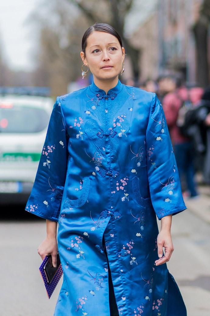 Rachael Wang in a blue kimono-style silk robe at Milan Fashion Week.