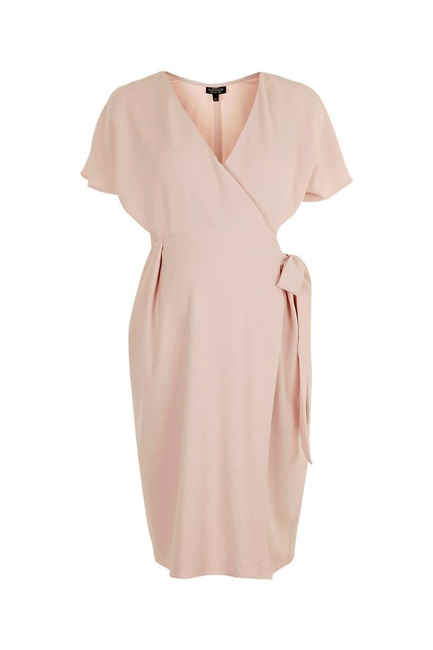 "<p> If you're looking for a date night dress with a bit of room, this blush pink wrap dress is the one for you.<p> <p> <a href=""http://www.topshop.com/en/tsuk/product/clothing-427/maternity-456/maternity-wrap-midi-dress-5580996?bi=100&ps=20"">Dress, $73, Topshop.</a>"