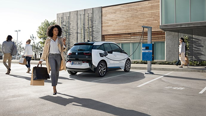 Woman with her electric car.