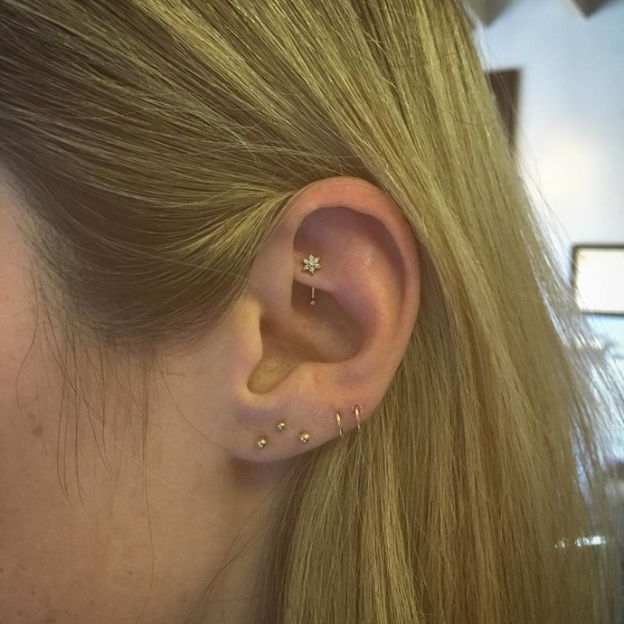 """<p>The constellation piercing on this lobe is subtle but makes a huge impact at the same time. Having all the jewellery in the same colourway makes it look incredibly cool. <p><a href=""""https://www.instagram.com/p/BJHNX_MB_cE/"""" target=""""_blank"""">Instagram.com/bodyelectrictattoo</a>"""