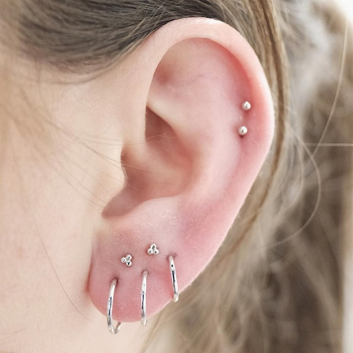 """<p>This white gold cluster works because the lobes are large enough to fit all the piercings. <p><a href=""""https://www.instagram.com/p/BL02Aw3hSuA/"""" target=""""_blank"""">Instagram.com/bentauber</a>"""
