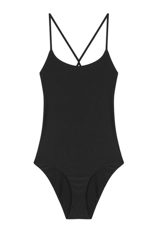 """<a href=""""https://www.mychameleon.com.au/cross-back-maillot-black-p-4615.html?typemf=women"""">Swimsuit, $190, Matteau at mychameleon.com.au.</a>"""