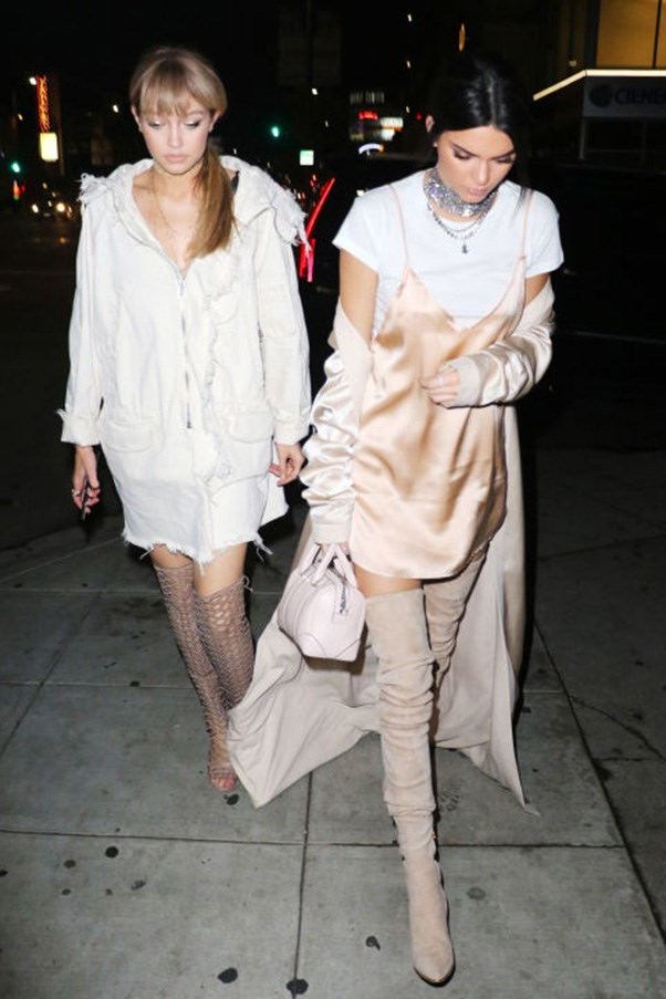 <strong>White outfit with nude over-the-knee boot twins</strong><br><br> In West Hollywood on April 9, 2016.<br><br> Image: Splash