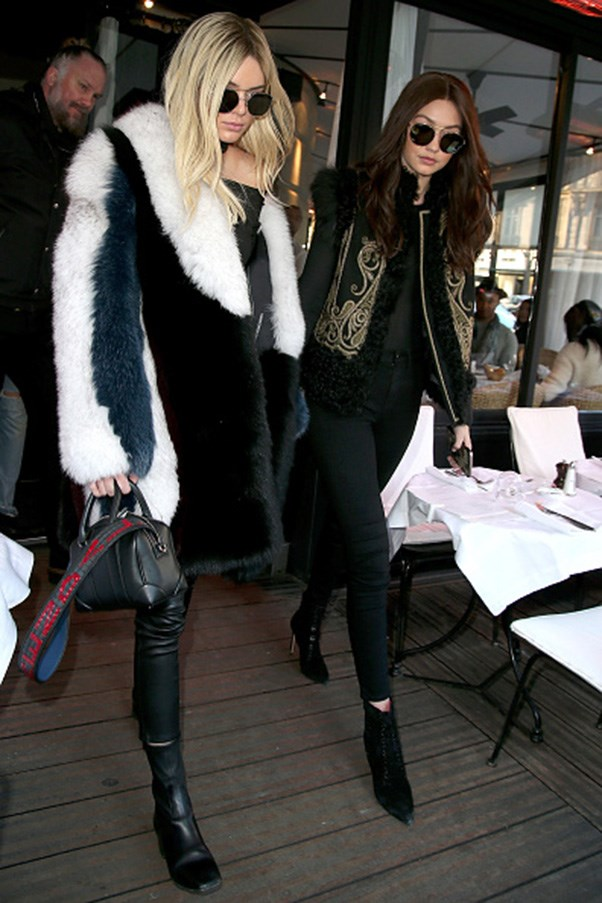<strong>Black shades and giant fur coat twins</strong><br><br> Walking in Paris during fashion week on March 3, 2016.