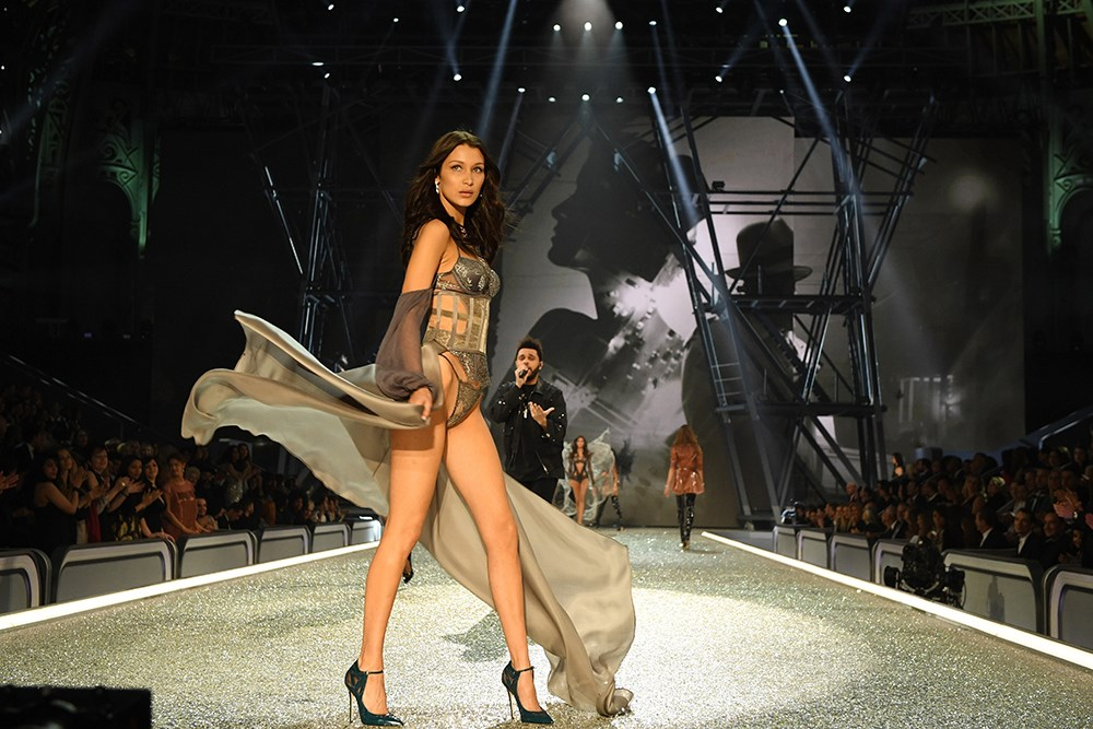 <p>See the pictures from Bella Hadid and The Weeknd's very public reunion at the Victoria's Secret Fashion Show. They split in November after two years of dating.