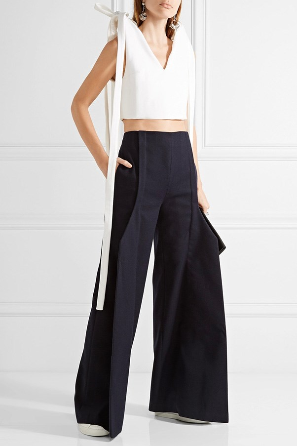 "Jacquemus cropped top, was $499, now $250, <a href=""https://www.net-a-porter.com/au/en/product/757699/jacquemus/cropped-bow-embellished-cotton-pique-top"">Net-a-Porter</a>"