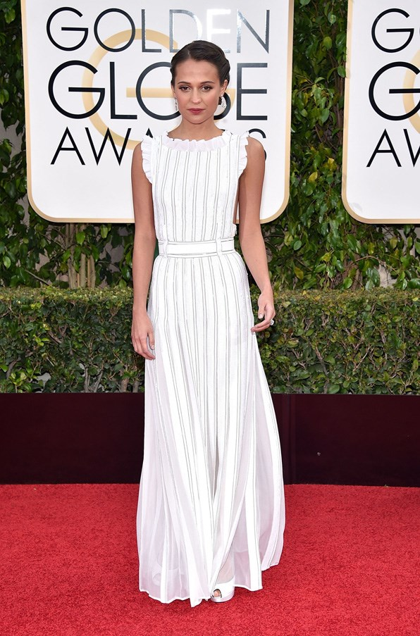 <P><strong>ALICIA VIKANDER IN LOUIS VUITTON</strong> <BR><BR> As one of the faces of Louis Vuitton, it was expected that Vikander would wear the brand for every major awards ceremony. Her sparkly white Golden Globes look was one of the best.