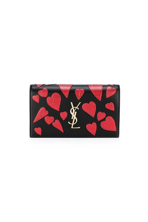 """Saint Laurent clutch, $1,720, <a href=""""https://www.farfetch.com/au/shopping/women/saint-laurent--monogram-clutch-item-11805670.aspx?storeid=9429&from=listing&tglmdl=1&ffref=lp_pic_26_4_"""">Farfetch</a>"""