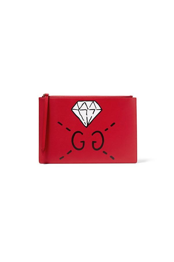 "Gucci pouch, $755, <a href=""https://www.net-a-porter.com/au/en/product/755469/gucci/printed-leather-pouch"">Net-a-Porter</a>"