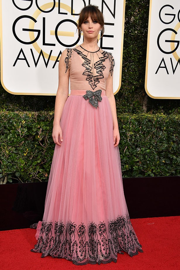 """<strong>Felicity Jones </strong> <br></br> As the rebellious heroine, Jyn, in Star Wars' latest release <em>Rogue One</em>, Felicity was always destined to have a place in our lives. But when she stepped out on the red carpet earlier this week wearing a dusty pink tulle Gucci number, finished with old-world detailing and an embellished bow, she solidified her foothold as a major up-and-comer in the fashion world. <br></br> Instagram: <a href=""""https://www.instagram.com/felicity.jones/?hl=en"""">@felicity.jones</a>"""