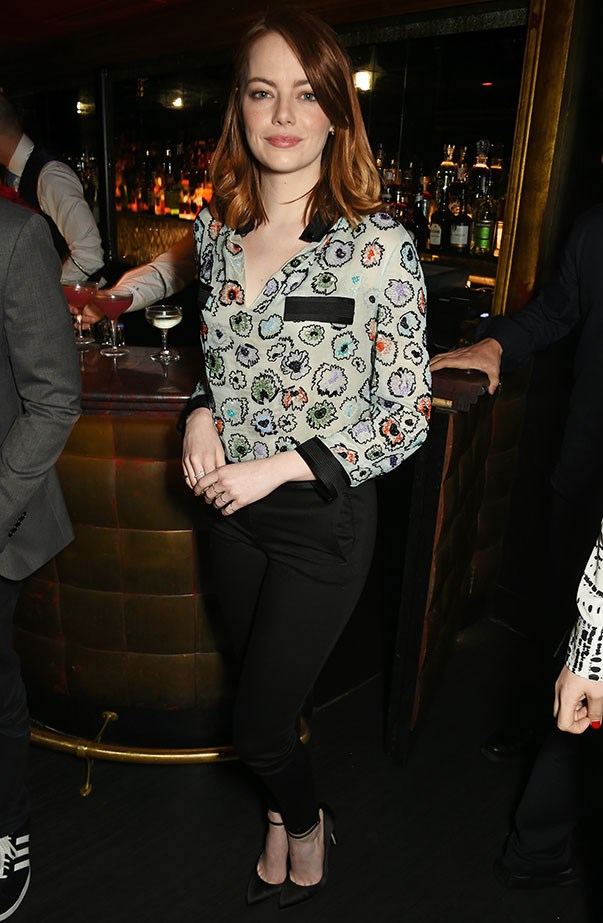 <p>Emma in a printed top and black pants at a special reception in honour of <em>La La Land</em>.