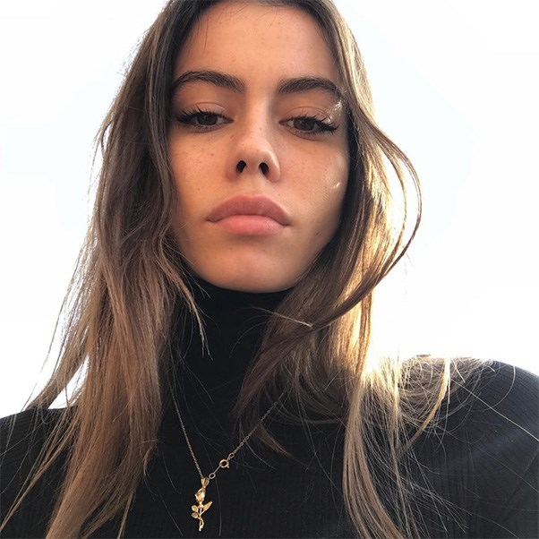 """Glossier model Madeleine Marie Angus shows a single gold necklace can elevate an entire look.<br><br> Image: Instagram <a href=""""https://www.instagram.com/madeleinemmarie/"""">@madeleinemmarie</a>"""