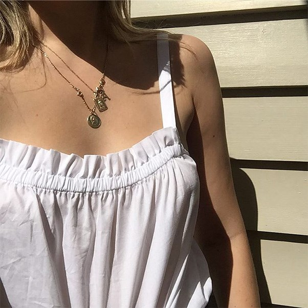 """Layering two necklaces on top of each other can still look minimal if you stick to a single colour/theme and keep everything else simple. <br><br> Image: Instagram <a href=""""https://www.instagram.com/p/BO2-miRAX4c/"""">@alexandrajy</a>"""