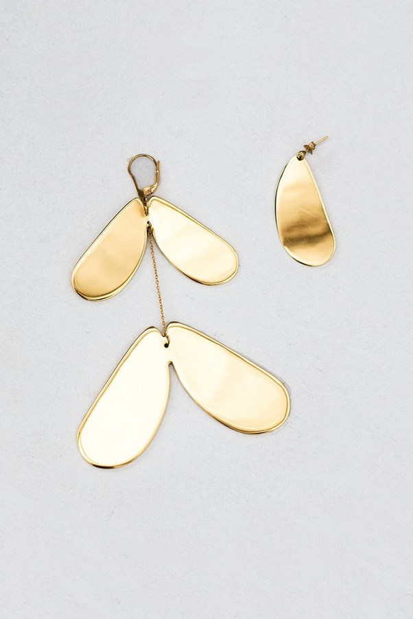 """<strong>Buy:</strong> Ellery earrings, $350, <a href=""""https://www.theundone.com/products/ellery-poet-earrings-gold?variant=29856538119"""">The Undone</a>"""