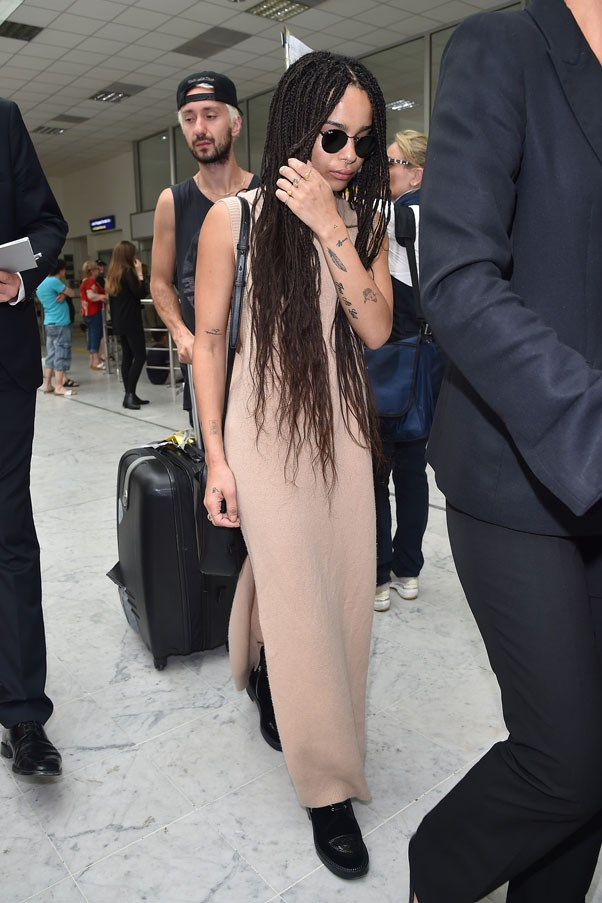 Kravitz elevates basics to new heights in this nude maxi dress paired with chunky black boots and shades.