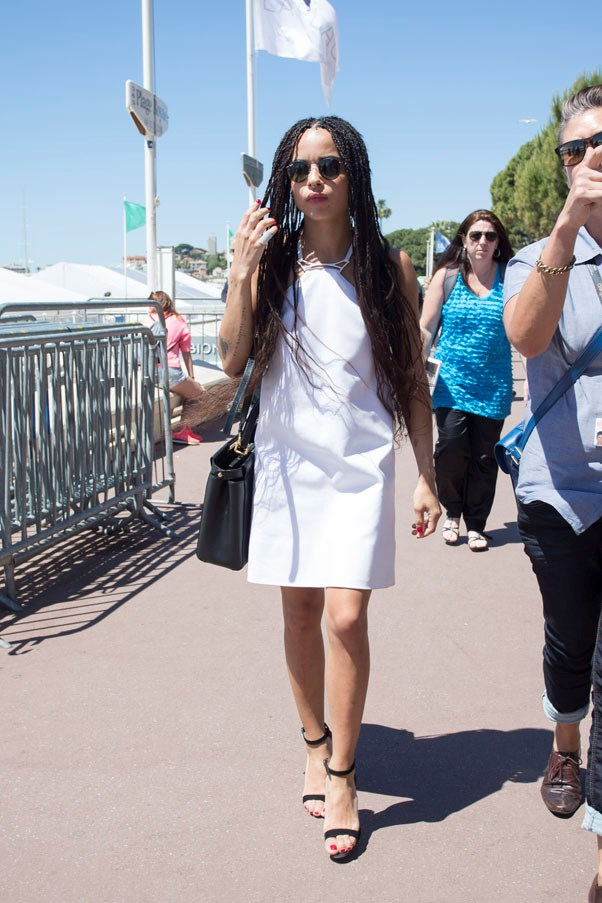 Kravitz wearing a simple white shift dress and her signature black shades while out and about in Cannes.