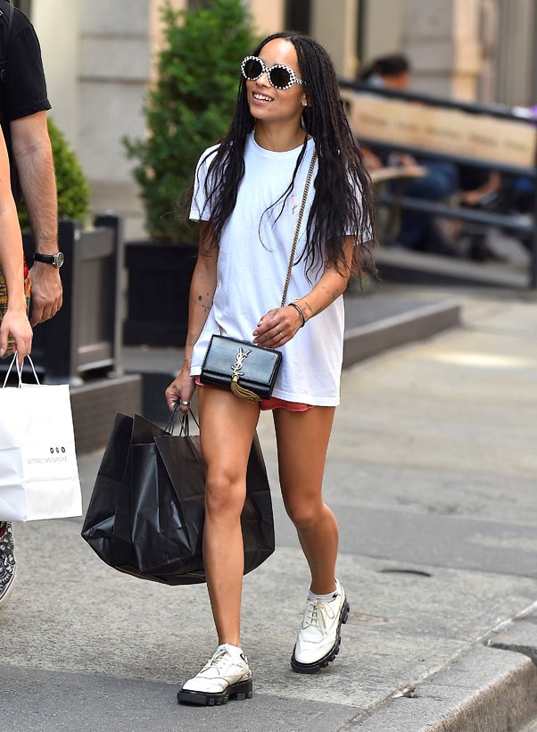 Give an oversized white T-shirt an edge by experimenting with accessories. Brogues and socks? Check. Patterned sunglasses? Check. Saint Laurent crossbody? Check.