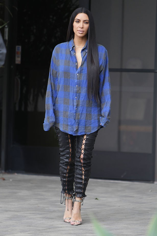 Kim Kardashian steps out wearing a slouchy lumberjack shirt for the second time this year.