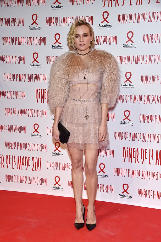 Diane Kruger debuts her own take on the sheer fashion trend at the Sidaction Gala Dinner wearing this  powder pink mini and matching faux fur stole. Extra points are awarded for finishing the feminine look with grunge-inspired makeup and punk-black accessories.
