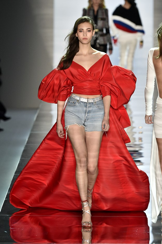 <p>Evidence #1: Alexandre Vauthier presents denim shorts with a red taffeta blouse with train in his Haute Couture Spring/Summer 2017 runway.
