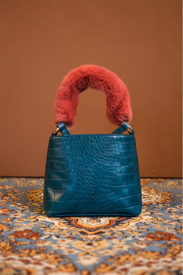 "'Forziéri' bag, approx. $117 at <a href=""https://theloeil.com/collections/bags/products/forzieri-bag-blue"">Loéil</a>"