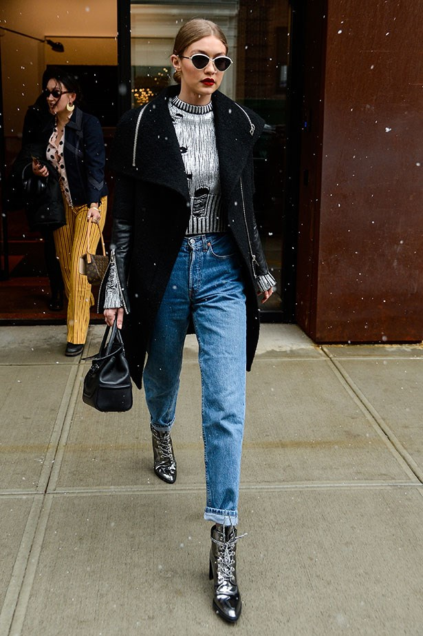 "Gigi Hadid stepped out in NYC sporting a pair of gunmetal hiking boots from her new line for <a href=""http://www.stuartweitzman.hk/en/c/GIGI/p/GIGI-IRON-SPECCHIO"">Stuart Weitzman</a>."