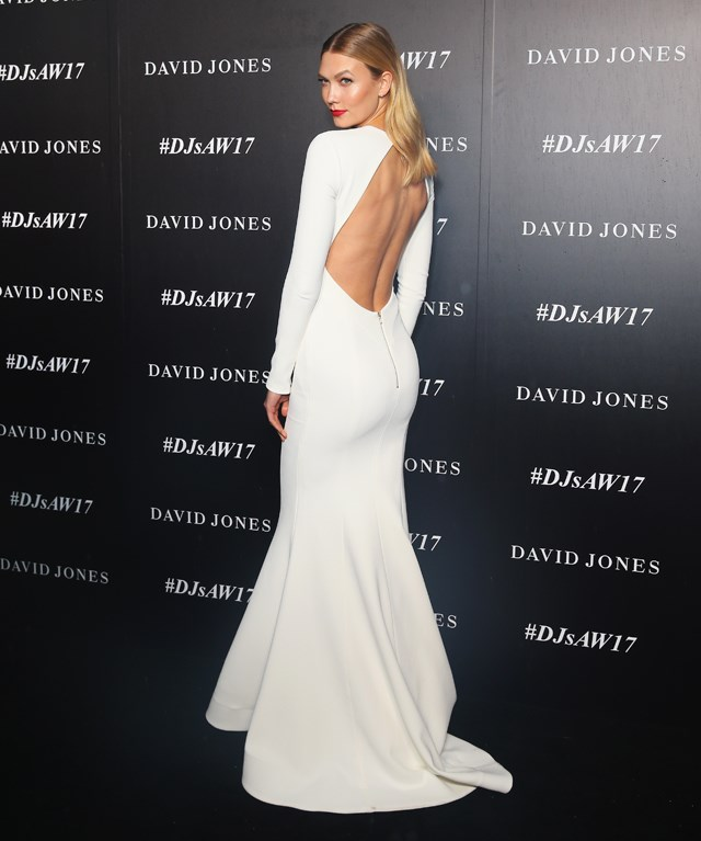 Karlie Kloss went with an open back to add a flash of skin to her high-neck, long-sleeved Rebecca Vallance gown.