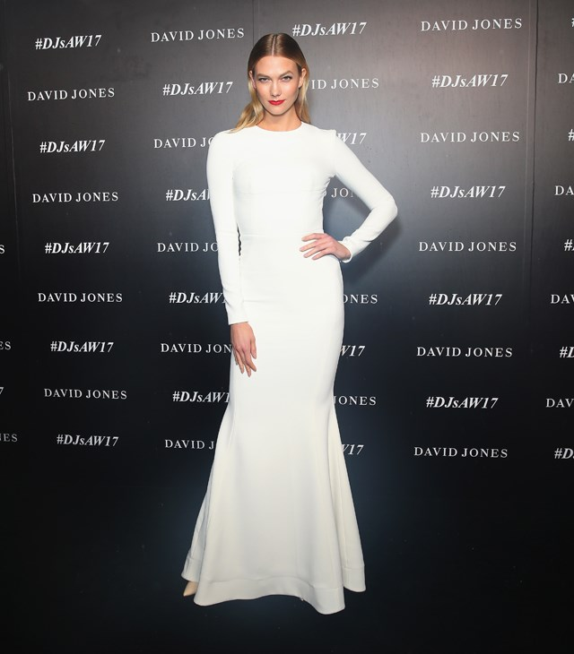 For a rare rainy Sydney night, Karlie went with a high-neck, long-sleeved Rebecca Vallance dress, with a gorgeous open back.