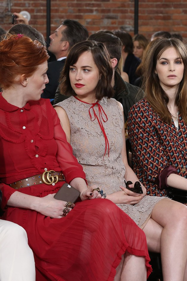 A newly-shorn Dakota wore this lace dress with bow neck-detail to a Gucci show.