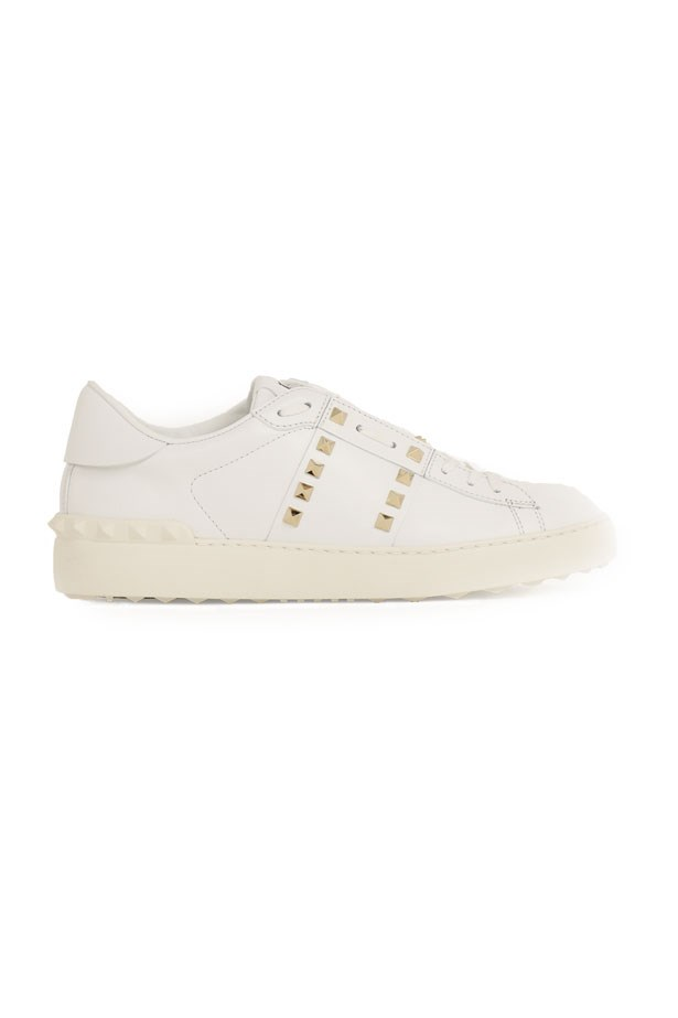 """Valentino Rockstud, $1015 at <a href=""""http://www.parlourx.com/brands/valentino/rockstud-open-sneaker-smooth-leather-white.html"""">Parlour X</a>."""