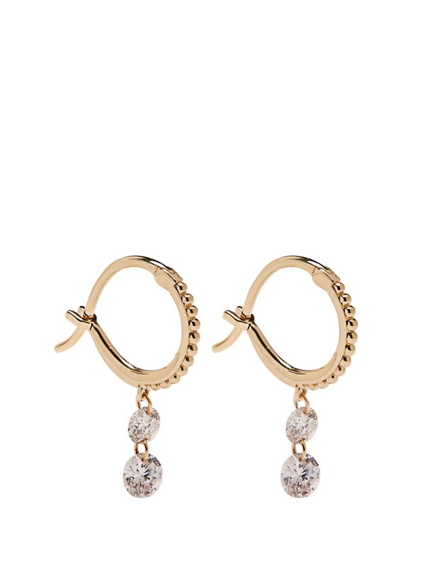 "<p>Raphaele Canot earring, approx. $6, 924 at <a href=""https://www.ylang23.com/product/double+diamond+set+free+mini+hoop+earrings+-+yellow+gold.do?sortby=nameAscend&refType=&from=fn&ecList=7&ecCategory=101881#"">Ylang 23</a>"