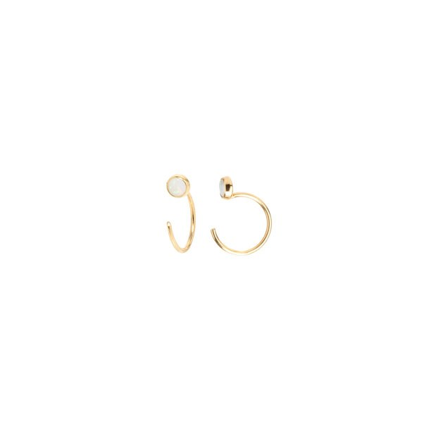 "<p>Zoe Chicco earrings, approx. $228 at <a href=""http://zoechicco.com/collections/earrings/products/14k-opal-tiny-open-hoop-earring"">Zoe Chicco</a>"