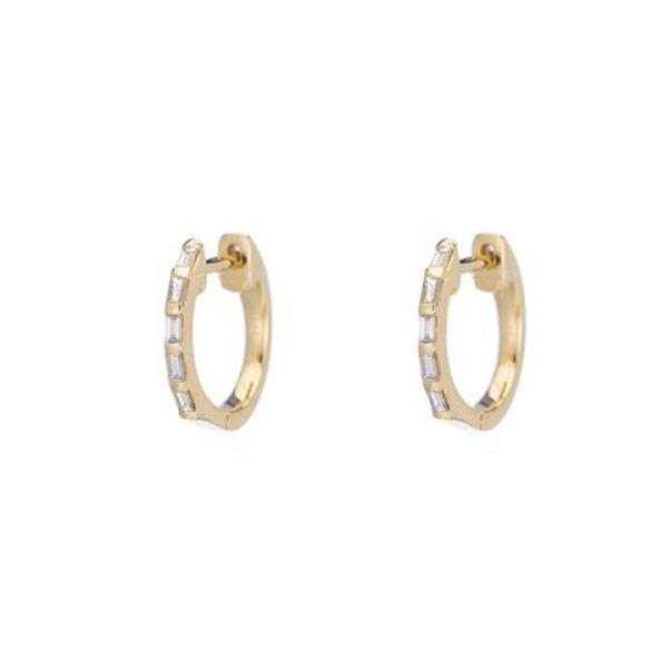 "<p>Ariel Gordon earrings, approx. $1,167 at <a href=""https://www.arielgordonjewelry.com/collections/huggies-and-hoops/products/baguette-diamond-huggies"">Ariel Gordon</a>"
