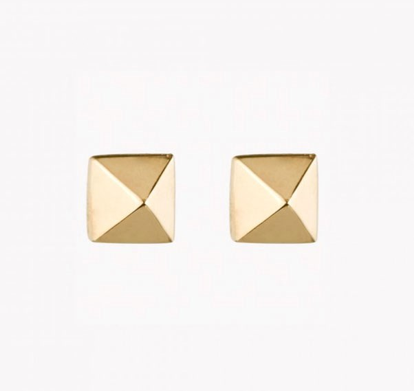 "<p>Eddie Borgo earrings, approx. $110 at <a href=""http://www.eddieborgo.com/jewelry/earrings/pyramid-stud-earring-gold"">Eddie Borgo</a>"