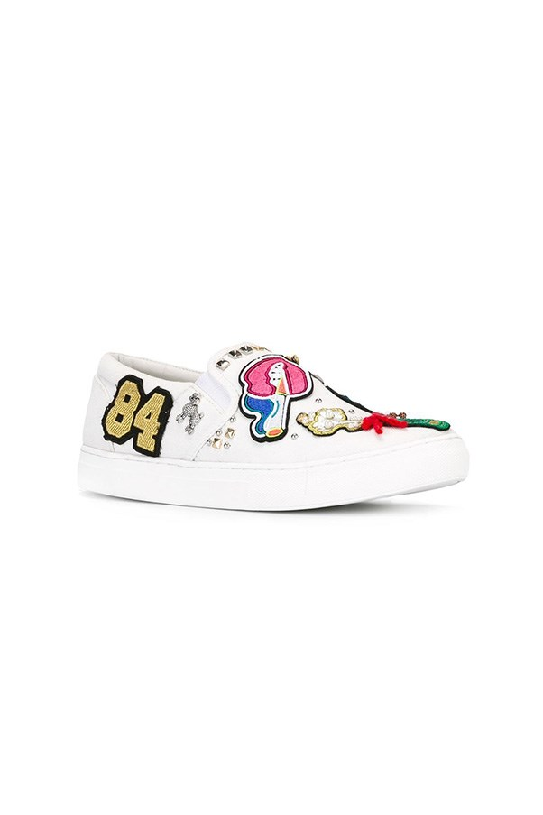 "Sneakers, $484, Saint Laurent at <a href=""https://www.farfetch.com/au/shopping/women/marc-jacobs-mercer-slip-on-sneakers-item-11833895.aspx?storeid=9336&from=listing&rnkdmnly=1&ffref=lp_pic_96_33_"">Farfetch</a>"
